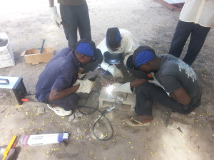 3.1 Welder with men using
